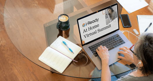 Educator accessing the i-Ready At-Home Virtual Summits on a laptop.