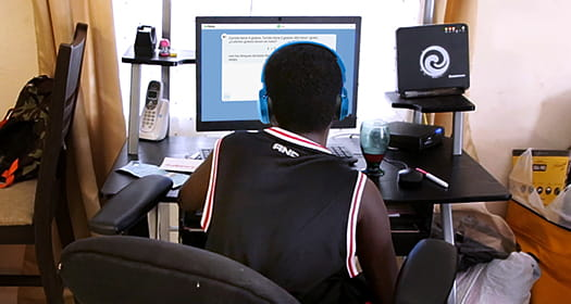 Student working on i-Ready on a computer at home.