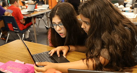 Two students using i-Ready online lessons in a classroom.